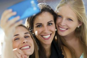 Three young woman enjoying a night out and taking a selfie in Rocky River OH