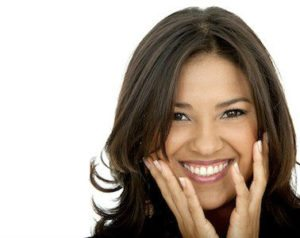 Woman showing off bright white smile from teeth whitening cosmetic dentistry at Rocky River Dentist.