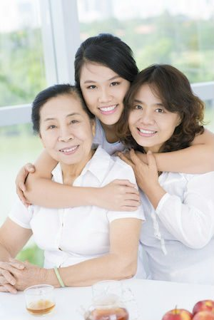 Three generations of Asian woman with healthy smiles from good preventive dentistry at Rocky River Dental
