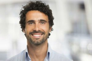 Man with healthy smile from restorative therapy from Rocky River Dental.